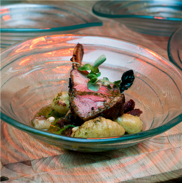 Action Station - Roasted rack of lamb, sweet potato gnocchi, lamb bacon, toasted pine nuts, pesto oil